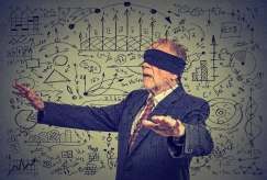 blindfolded senior business man walking through social media data